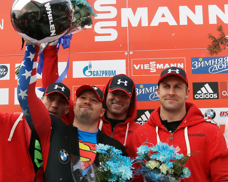 . United States\' Christopher Fogt, Steven Holcomb, Steven Langton and Curtis Tomasevicz celebrate their win in the four-man bobsled World Cup event on Sunday, Dec. 15, 2013, in Lake Placid, N.Y. (AP Photo/Mike Groll)