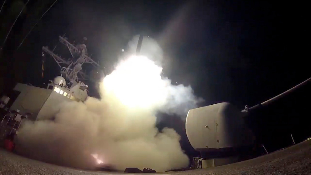 . In this image from video provided by the U.S. Navy, the guided-missile destroyer USS Porter (DDG 78) launches a tomahawk land attack missile in the Mediterranean Sea, Friday, April 7, 2017. The United States blasted a Syrian air base with a barrage of cruise missiles in fiery retaliation for this week\'s gruesome chemical weapons attack against civilians.  (Mass Communication Specialist 3rd Class Ford Williams/U.S. Navy via AP)