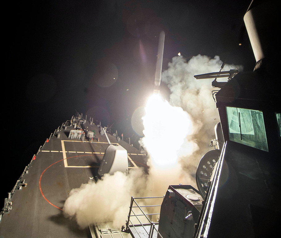 . In this image provided by the U.S. Navy, the USS Ross (DDG 71) fires a tomahawk land attack missile Friday, April 7, 2017, from the Mediterranean Sea. The United States blasted a Syrian air base with a barrage of cruise missiles in fiery retaliation for this week\'s gruesome chemical weapons attack against civilians.  (Mass Communication Specialist 3rd Class Robert S. Price/U.S. Navy via AP)