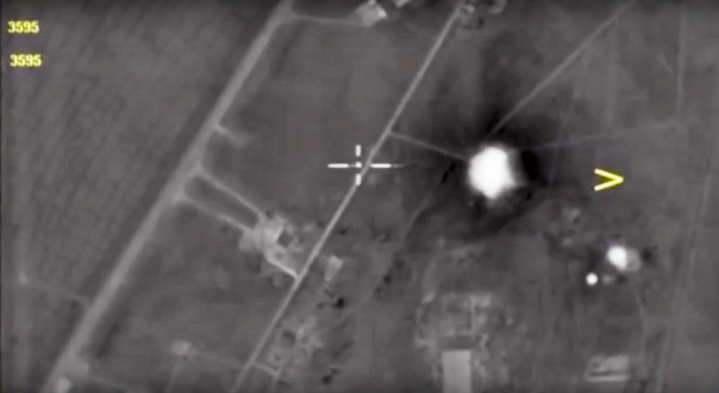 . In this photo made from the footage taken from Russian Defense Ministry official web site Friday, April 7, 2017, an aerial view shows a Syrian airbase after it was hit by US strike in Syria. Russia reacted to U.S. military strikes on its ally Syria Friday by cutting a hotline intended to prevent midair incidents, a response that demonstrates Moscow\'s readiness to defy Washington.  (Russian Defense Ministry Press Service Photo via AP)