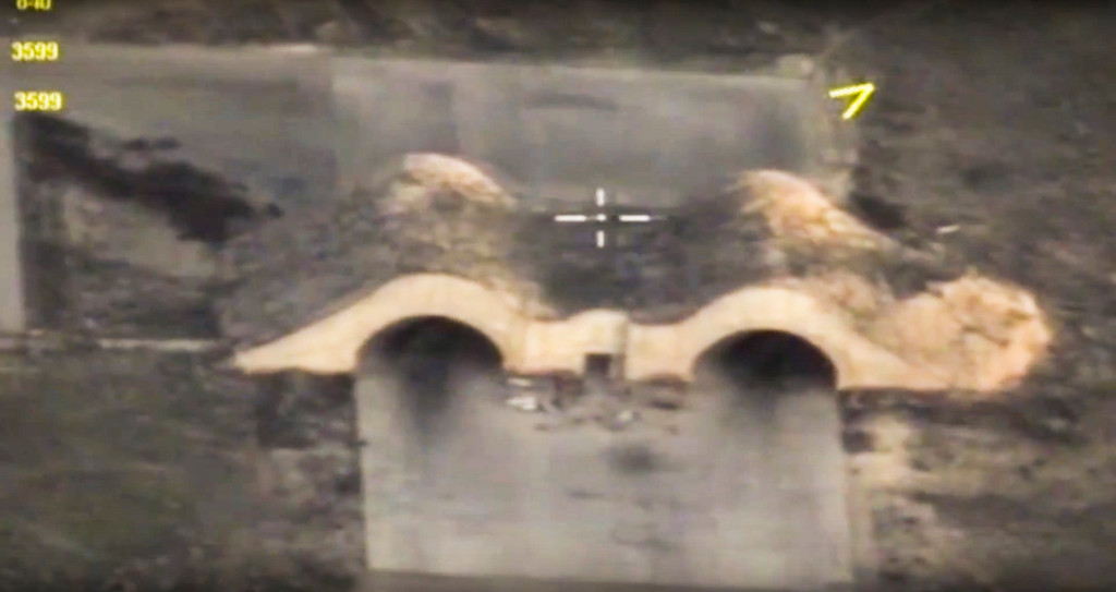 . In this photo made from the footage taken from Russian Defense Ministry official web site Friday, April 7, 2017, an aerial view shows shelters for aircraft at a Syrian airbase after it was hit by US strike in Syria. Russia reacted to U.S. military strikes on its ally Syria Friday by cutting a hotline intended to prevent midair incidents, a response that demonstrates Moscow\'s readiness to defy Washington. (Russian Defense Ministry Press Service Photo via AP)
