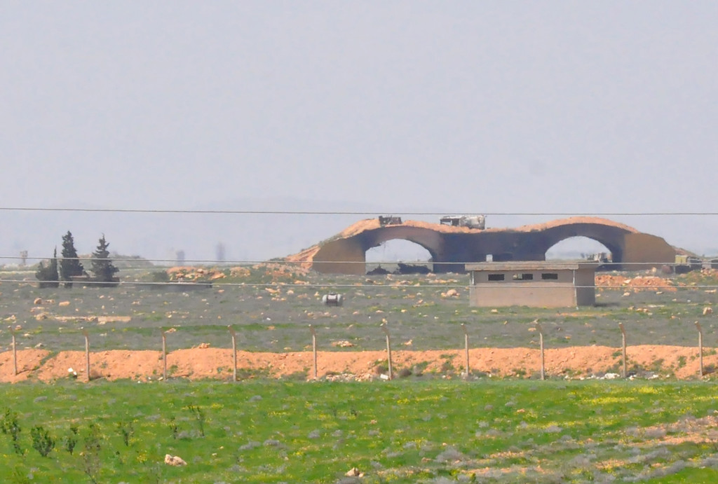 ". A picture taken on April 7, 2017 shows a view of the damaged Shayrat (""ash-Shairat\"") airfield at the Syrian government forces military base targeted earlier overnight by US Tomahawk cruise missiles, southeast of the central and third largest Syrian city of Homs. (STRINGER/AFP/Getty Images)"