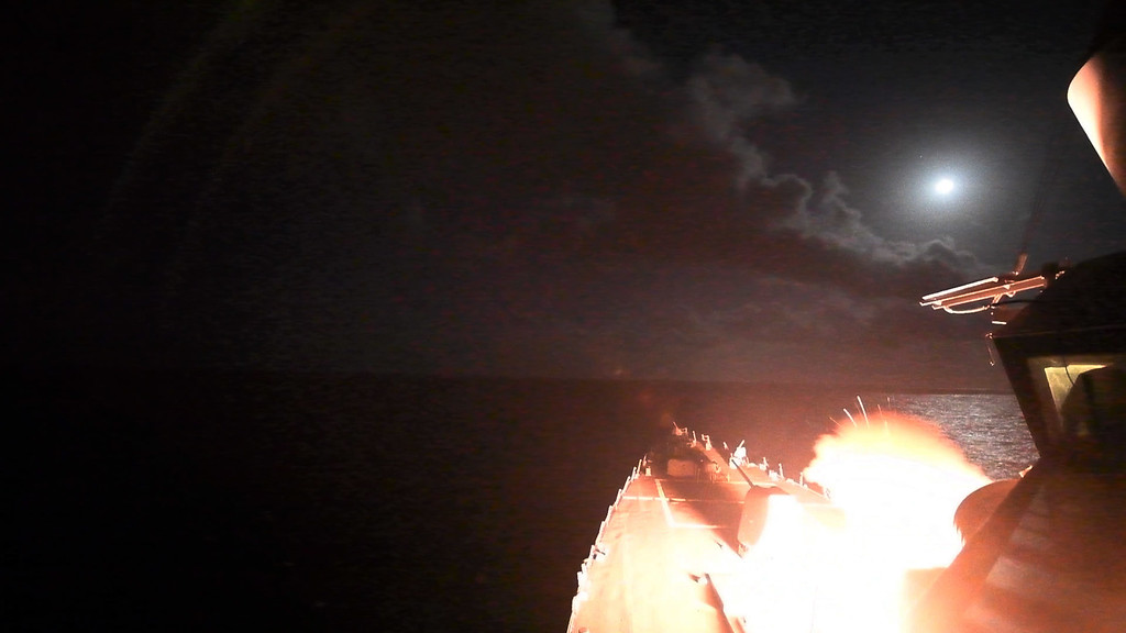 . In this image provided by the U.S. Navy, the guided-missile destroyer USS Porter (DDG 78) launches a tomahawk land attack missile in the Mediterranean Sea, Friday, April 7, 2017. The United States blasted a Syrian air base with a barrage of cruise missiles in fiery retaliation for this week\'s gruesome chemical weapons attack against civilians.  (Mass Communication Specialist 3rd Class Ford Williams/U.S. Navy via AP)