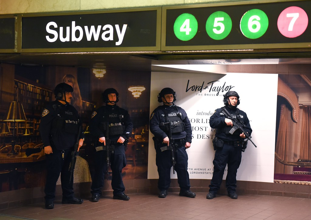 . New York Police Department officers (NYPD) stand guard at the entrance to the subway at Grand Central Station on April 7, 2017 in New York, the morning after the US launched an airstrike on military targets in Syria. (TIMOTHY A. CLARY/AFP/Getty Images)