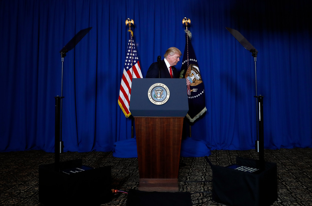 . President Donald Trump walks from the podium after speaking at Mar-a-Lago in Palm Beach, Fla., Thursday, April 6, 2017, after the U.S. fired a barrage of cruise missiles into Syria Thursday night in retaliation for this week\'s gruesome chemical weapons attack against civilians. (AP Photo/Alex Brandon)
