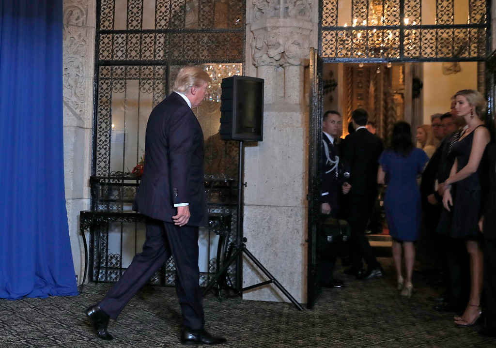 . President Donald Trump walks from the podium after speaking at Mar-a-Lago in Palm Beach, Fla., Thursday, April 6, 2017, after the U.S. fired a barrage of cruise missiles into Syria Thursday night in retaliation for this week\'s gruesome chemical weapons attack against civilians. At right is his daughter Ivanka Trump. (AP Photo/Alex Brandon)