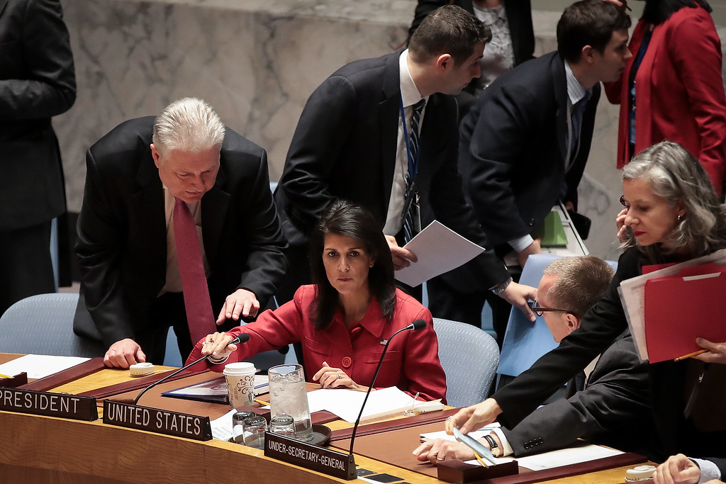 . NEW YORK, NY - APRIL 7: (L to R) Representative of Ukraine to the United Nations Volodymyr Yelchenko speaks to U.S. Ambassador to the United Nations Nikki Haley during a meeting of the United Nations Security Council concerning the situation in Syria, at UN headquarters, April 7, 2017 in New York City. On Thursday night, the United States launched airstrikes directed at Syrian government air bases in response to the chemical attack earlier in the week. (Photo by Drew Angerer/Getty Images)