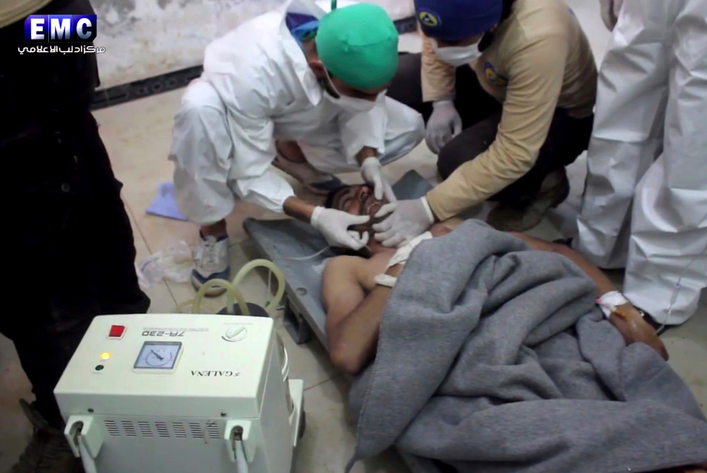 . This frame grab from video provided on Tuesday April 4, 2017, by the Syrian anti-government activist group Edlib Media Center, that is consistent with independent AP reporting, shows a victim of a suspected chemical attack as he receives treatment at a makeshift hospital, in the town of Khan Sheikhoun, northern Idlib province, Syria. The suspected chemical attack killed dozens of people on Tuesday, Syrian opposition activists said, describing the attack as among the worst in the country\'s six-year civil war. (Edlib Media Center, via AP)