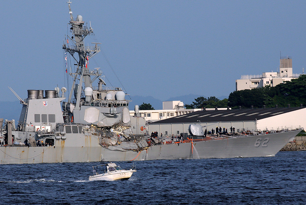 . The damaged USS Fitzgerald is seen near the U.S. Naval base in Yokosuka, southwest of Tokyo, after the U.S. destroyer collided with the Philippine-registered container ship ACX Crystal in the waters off the Izu Peninsula Saturday, June 17, 2017. The USS Fitzgerald was back at its home port in Japan after colliding before dawn Saturday with a container ship four times its size, while the coast guard and Japanese and U.S. military searched for seven sailors missing after the crash. (AP Photo/Eugene Hoshiko)