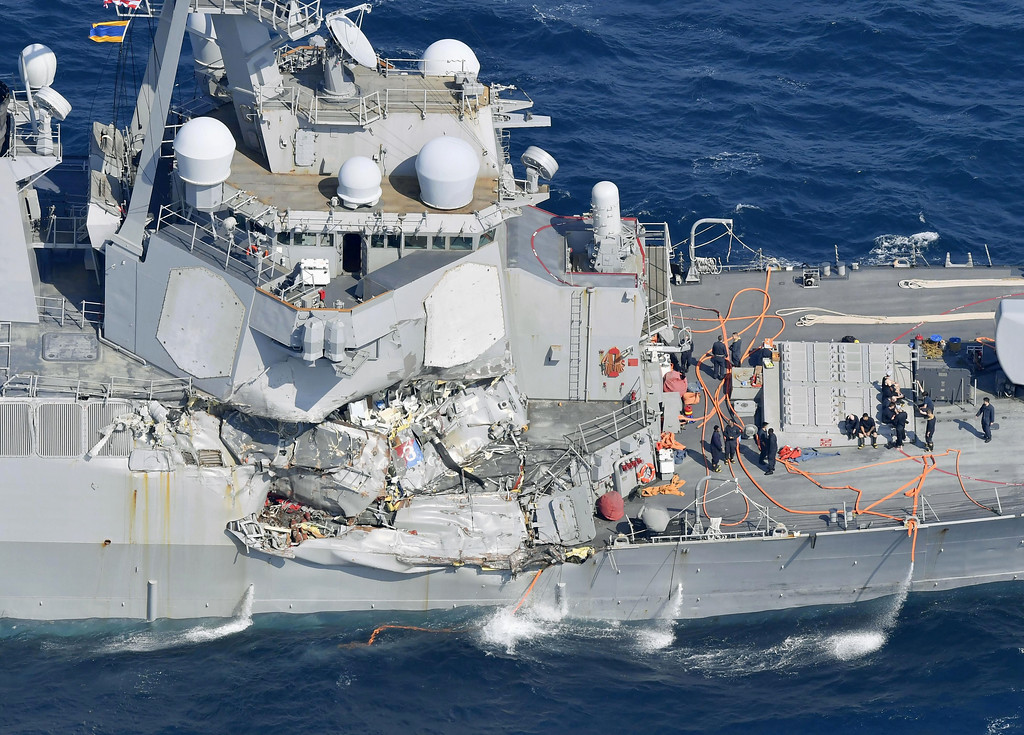. The damage of the right side of the USS Fitzgerald is seen off Shimoda, Shizuoka prefecture, Japan, after the Navy destroyer collided with a merchant ship, Saturday,  June 16, 2017.  The U.S. Navy says the USS Fitzgerald suffered damage below the water line on its starboard side after it collided with a Philippine-flagged merchant ship.  (Iori Sagisawa/Kyodo News via AP)