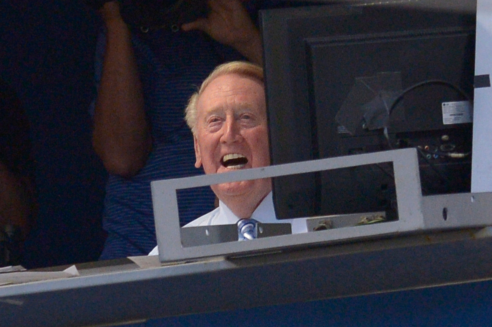 . Legendary Dodger Announcer Vin Scully laughs while watching Jimmy Kimmel on the big screen announce in the 2nd inning that he would be returning to the broadcast booth for another year. The Los Angeles Dodgers played the Chicago Cubs in a regular season MLB Baseball game at Dodger Stadium. Los Angeles, CA 8/28/2015 (photo by John McCoy Daily News)