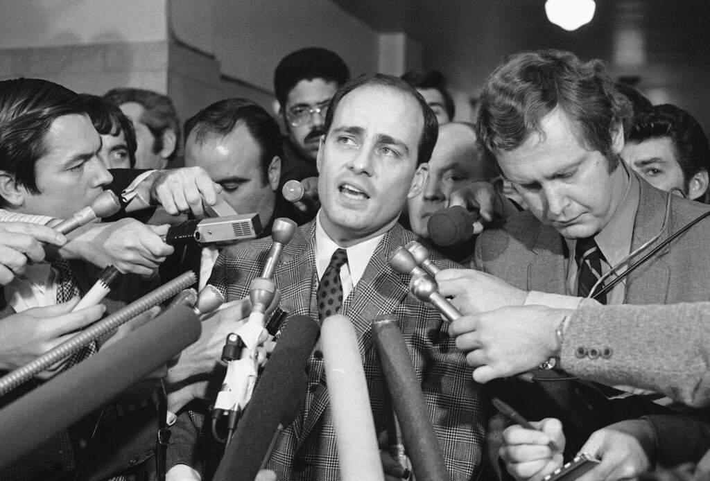 . Vincent Bugliosi, Chief Prosecutor in the trial of Manson and three young women, talk with newsmen outside the courtroom  Monday, Jan. 26, 1971 in Los Angeles. The four defendants had just been found guilty of first degree murder. (AP Photo)