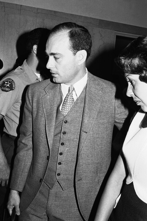 """. Deputy District Attorney Vincent Bugliosi arrives at a Los Angeles courtroom July 24, 1970, to present the opening argument in the trial of Charles Manson and three others for the slayings of actress Sharon Tate and six others in Los Angeles. He said a song by the Beatles inspired Manson to order the slayings in order to start a \""""black-white revolution.\"""" (AP Photo/Wally Fong )"""