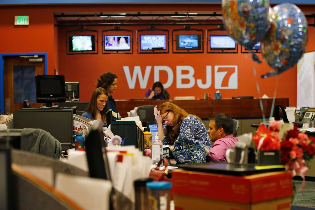 . Members of the WDBJ-TV7 news staff prepare for the early morning newscast at the station, in Roanoke, Va., Thursday, Aug. 27, 2015. A reporter and cameraman from the station were killed during a live broadcast Wednesday, by a former colleague. (AP Photo/Steve Helber)