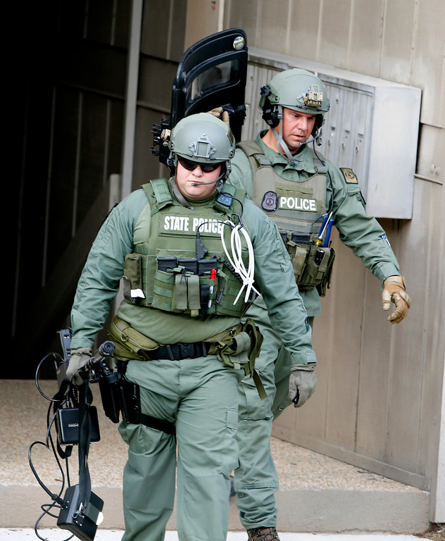 . State Police officers leave the apartment of Vester Lee Flanagan II, in Roanoke, Va., Wednesday, Aug. 26, 2015.  Flanagan filmed himself gunning down a WDBJ-TV reporter and cameraman during a live television interview Wednesday and posted the video on social media after fleeing the scene.  (AP Photo/Steve Helber)