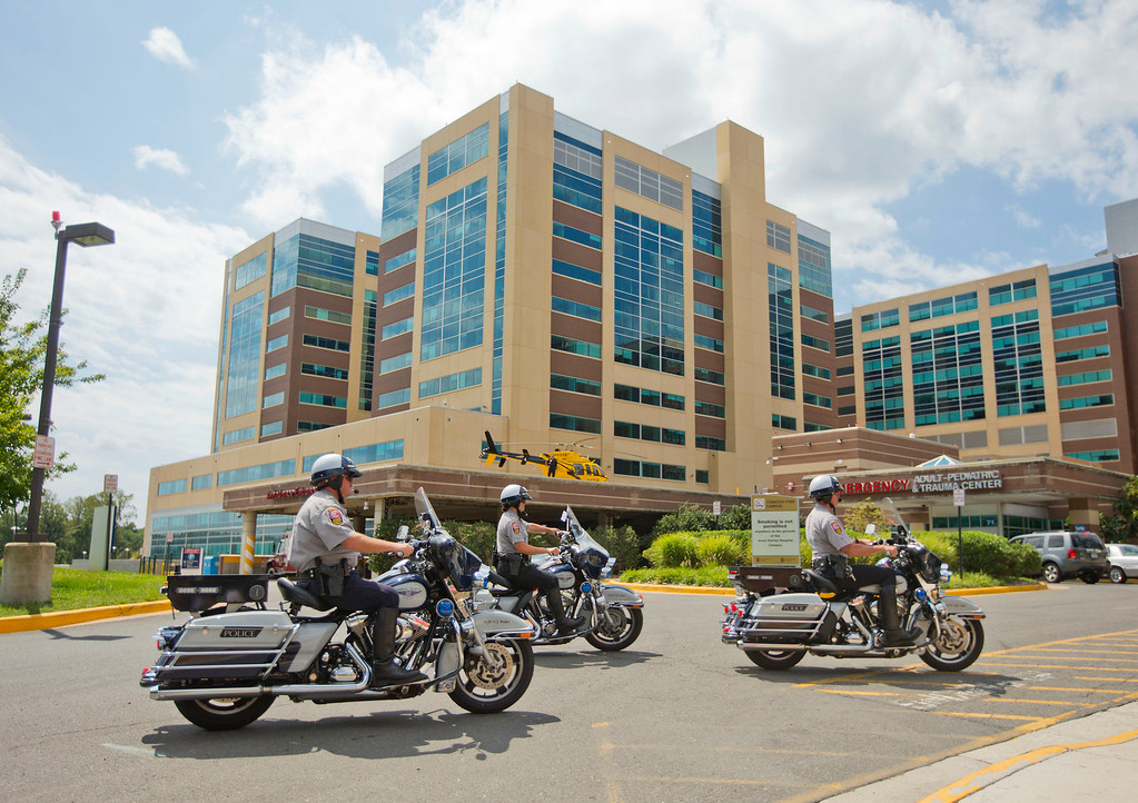 . Law enforcement officers arrive at the emergency and trauma center at INOVA Fairfax Medical Center in Falls Church, Va., Wednesday, Aug. 26, 2015. The suspect in the shooting of reporter and cameraman at the Bridgewater Plaza in Franklin County, Va. died of self-inflicted gunshot wound at the hospital. (AP Photo/Pablo Martinez Monsivais)