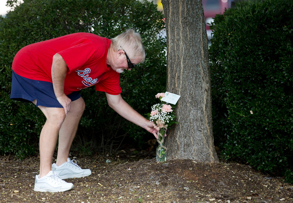 ". Rodney Booth, of Roanoke, Va., delivers flowers to WDBJ\'s Digital Broadcast Center, in Roanoke, Va., after hearing news of the fatal shooting of two of the station\'s journalists earlier in the day, Wednesday, Aug. 26, 2015. ""They\'re kind of like family because I see them every morning,\"" said Booth. (Erica Yoon/The Roanoke Times via AP)"