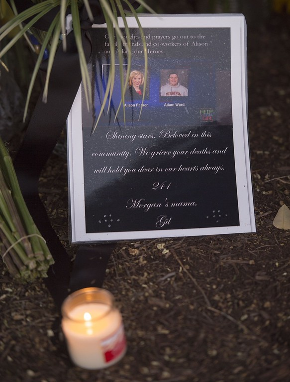 . A makeshift memorial for reporter Alison Parker, 24, and cameraman Adam Ward, 27, at the gate of WDBJ television studios on August 26, 2015,  in Roanoke, Virginia. Former reporter Vester Lee Flanagan fired by Virginia television station WDBJ shot dead the two journalists during a live broadcast Wednesday and posted chilling footage of the crime online before fatally shooting himself.            (PAUL J. RICHARDS/AFP/Getty Images)