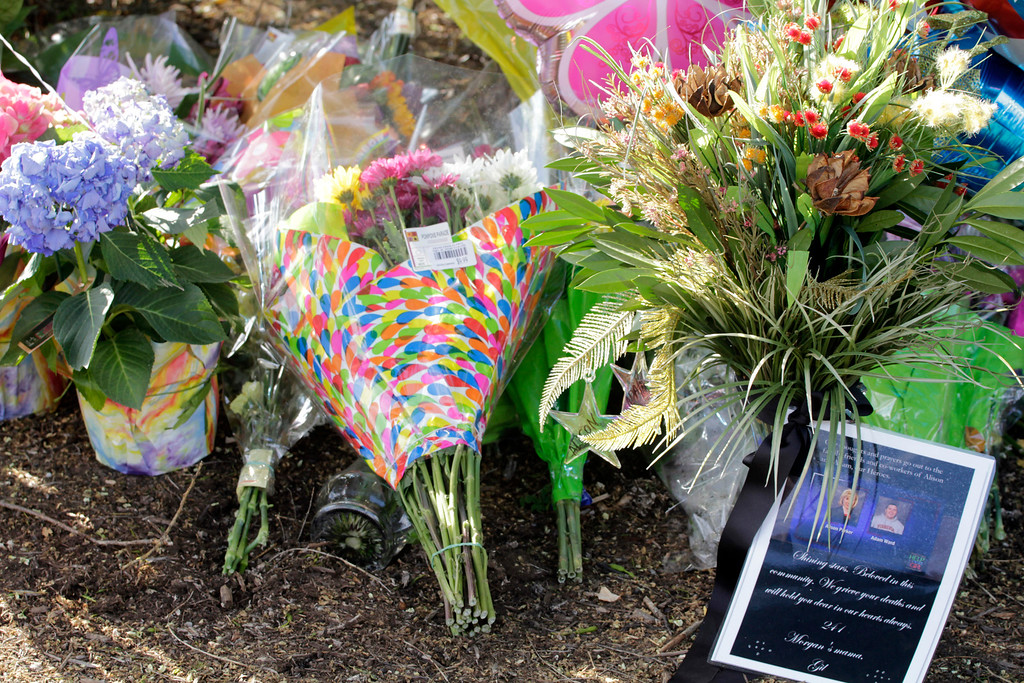 . Flowers are left for the two journalist that were killed this morning during a live broadcast on August 26, 2015 in Roanoke, Virginia. Two employees of WDBJ TV were killed this morning during a live broadcast at Bridgewater Plaza on Smith Mountain Lake. The victims have been identified as reporter Alison Parker and cameraman Adam Ward. Parker, 24 and Ward, 27, worked for WDBJ in Roanoke, Virginia. The suspect, Vester Lee Flanigan, also known as Bryce Williams, died of a self-inflicted gunshot wound. (Photo by Jay Paul/Getty Images)