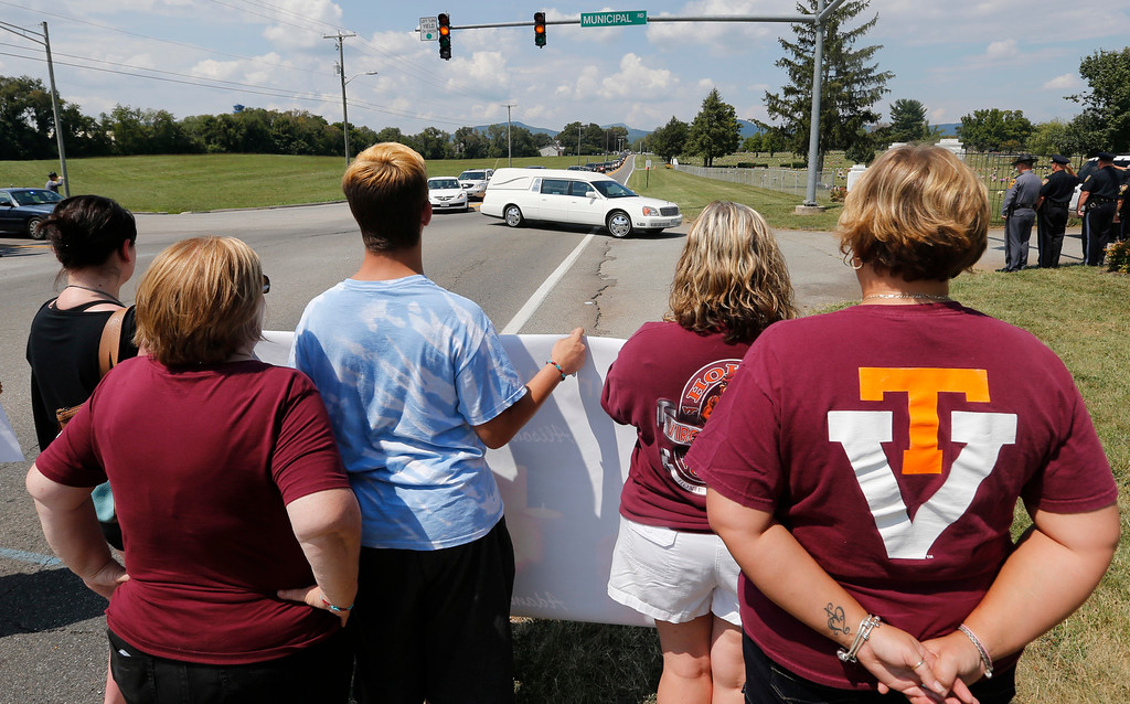 . People show their support at the funeral for WDBJ-TV cameraman Adam Ward at the Blue Ridge Memorial Garden cemetery in Roanoke, Va., Tuesday, Sept. 1, 2015.  Ward and WDBJ-TV morning reporter Alison Parker were fatally shot by a former co-worker on live television during an interview on Aug. 26. (AP Photo/Steve Helber)