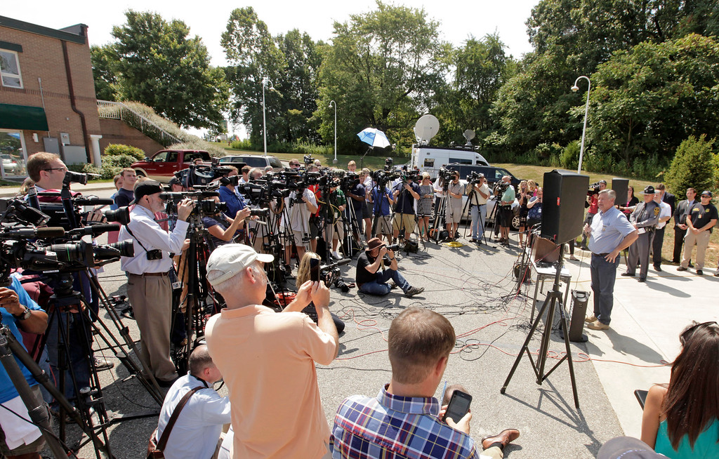 . Franklin County, Virginia sheriff, Bill Overton speaks to the press on August 26, 2015 in Moneta, Virginia. Two employees of WDBJ TV were killed this morning during a live broadcast at Bridgewater Plaza on Smith Mountain Lake. The victims have been identified as reporter Alison Parker and camerman Adam Ward. Parker, 24 and Ward, 27, worked for WDBJ in Roanoke, Virginia. The suspect, Vester Lee Flanigan, also known as Bryce Williams, died of a self-inflicted gunshot wound. (Photo by Jay Paul/Getty Images)