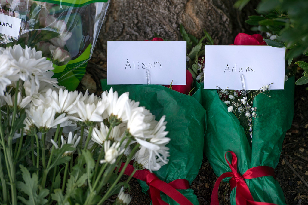 . Flowers, balloons and cards are left for the staff of WDBJ7 as well as cards for Alison Parker and Adam Ward in front of WDBJ\'s location in Roanoke, Va., Wednesday, Aug. 26, 2015. Vester Lee Flanagan opened fire during a live on-air interview for WDBJ7, killing the two journalists Wednesday. (Don Petersen/The Roanoke Times via AP)