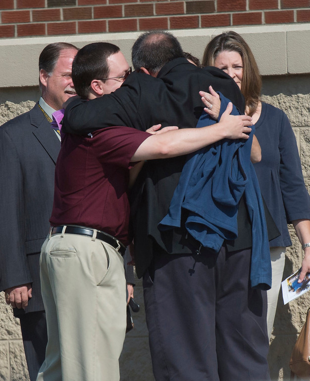 . Channel 7 colleagues and friends hug prior to the funeral for cameraman Adam Ward at First Baptist Church in Roanoke, Va., Tuesday, Sept. 1, 2015. Ward and fellow reporter Alison Parker were fatally shot by a former co-worker. (Don Petersen/The Roanoke Times via AP)