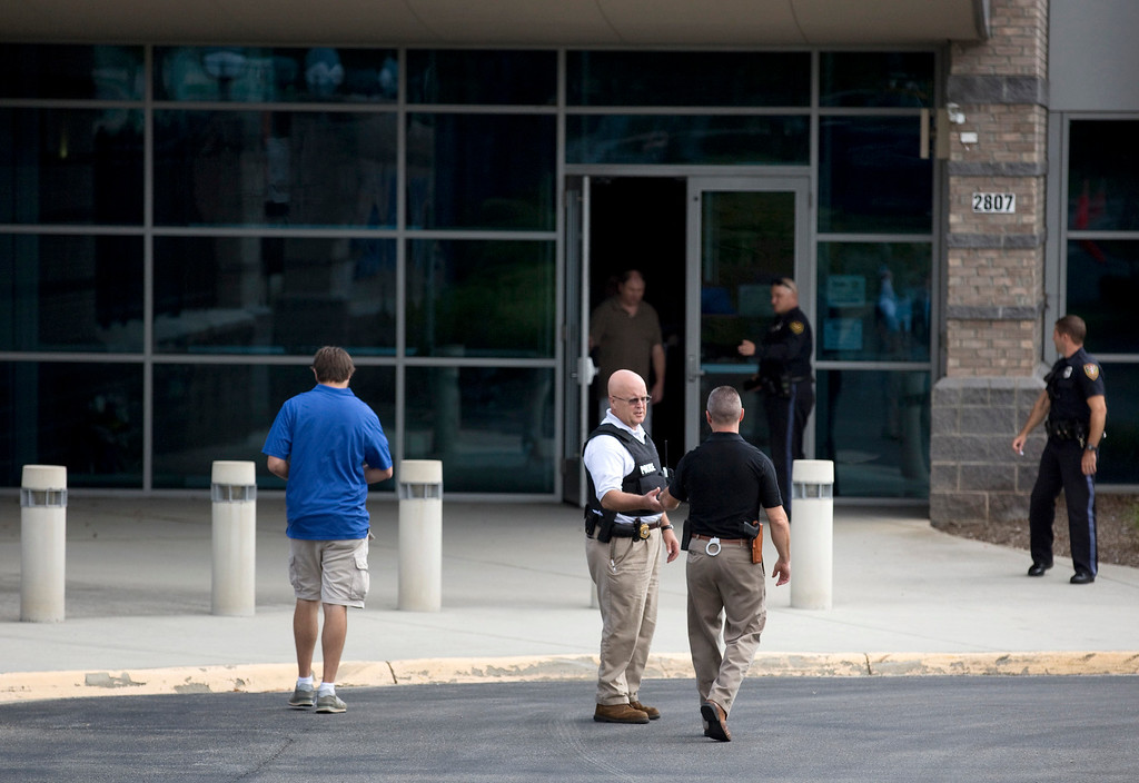 . Authorities work at WDBJ\'s Digital Broadcast Center, Wednesday, Aug. 26, 2015, in Roanoke, Va. Two of the station\'s journalists were fatally shot while doing an on-air broadcast earlier in the day at Bridgewater Plaza in Moneta, Va. (Erica Yoon/The Roanoke Times via AP)