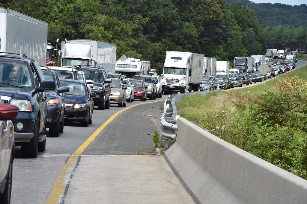 . A view of traffic backed up on Interstate 66 near Front Royal, Virginia on August 26, 2015 miles back from a police line where suspected killer Vester Lee Flanagan also known as Bryce Williams was caputred. The man suspected of killing two journalists WDBJ reporter Alison Parker, 24, and cameraman Adam Ward, 27, as they carried out a live interview in Virginia, Wednesday from a self-inflicted gunshot wound, a local official said. Vester Flanagan, also known as Bryce Williams, died at Inova Fairfax hospital in northern Virginia, just outside Washington, DC.           (PAUL J. RICHARDS/AFP/Getty Images)