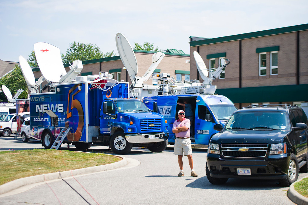 . Television news vehicles pack a parking lot before the start of a news conference regarding the shooting deaths of two WDBJ journalists in Westlake, Va., Wednesday, Aug. 26, 2015. The WDBJ reporter and cameraman were shot to death during a live television interview Wednesday by a gunman who recorded himself carrying out the killings and posted the video on social media after fleeing the scene. (Griffin Moores/The Daily News Leader via AP)