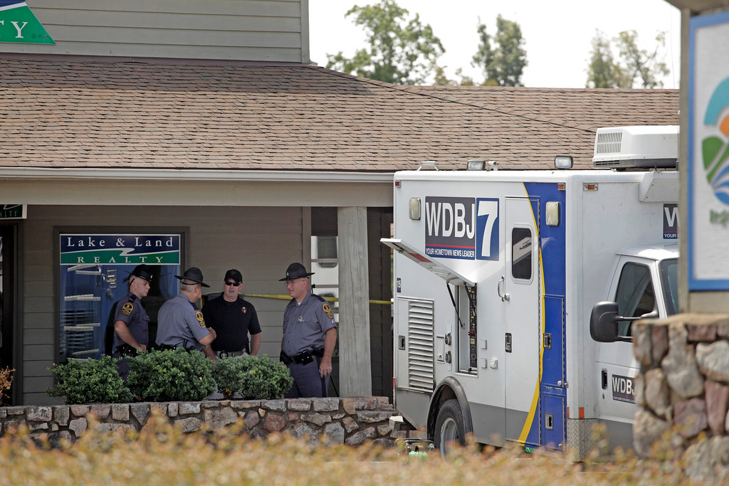 . Police work the crime scene at Bridgewater Plaza on Smith Mountain Lake on August 26, 2015 in Moneta, Virginia. Two employees of WDBJ TV were killed this morning during a live broadcast. The victims have been identified as reporter Alison Parker and camerman Adam Ward. Parker, 24 and Ward, 27, worked for WDBJ in Roanoke, Virginia. The suspect, Vester Lee Flanigan, also known as Bryce Williams, died of a self-inflicted gunshot wound. (Photo by Jay Paul/Getty Images)