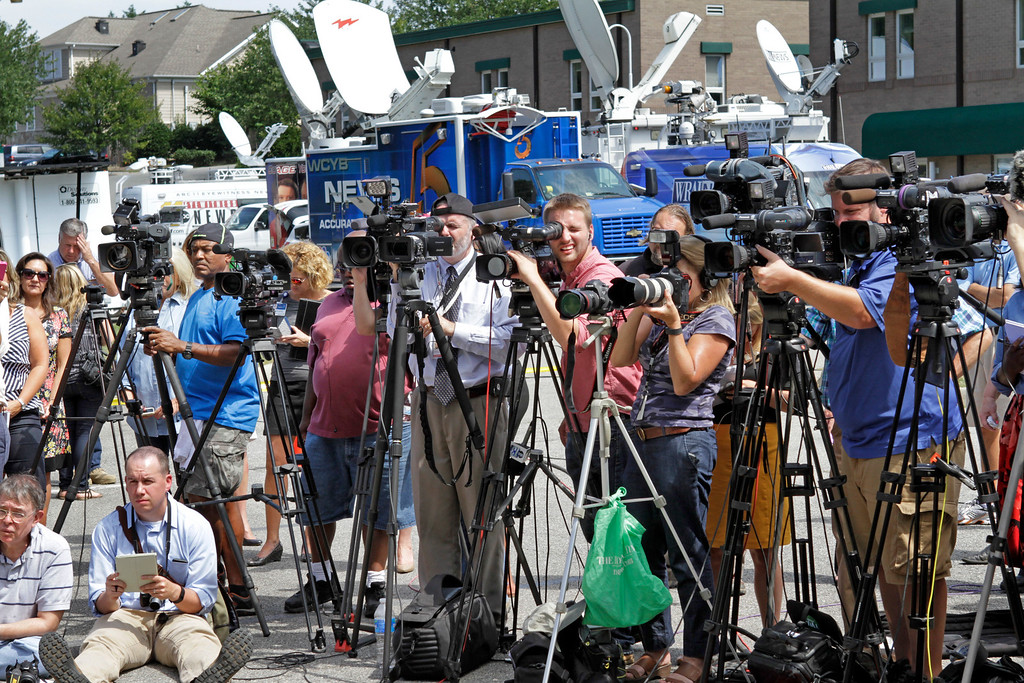 . The media attend a press conference by Franklin County, Virginia sheriff, Bill Overton on August 26, 2015 in Moneta, Virginia. Two employees of WDBJ TV were killed this morning during a live broadcast at Bridgewater Plaza on Smith Mountain Lake. The victims have been identified as reporter Alison Parker and camerman Adam Ward. Parker, 24 and Ward, 27, worked for WDBJ in Roanoke, Virginia. The suspect, Vester Lee Flanigan, also known as Bryce Williams, died of a self-inflicted gunshot wound. (Photo by Jay Paul/Getty Images)