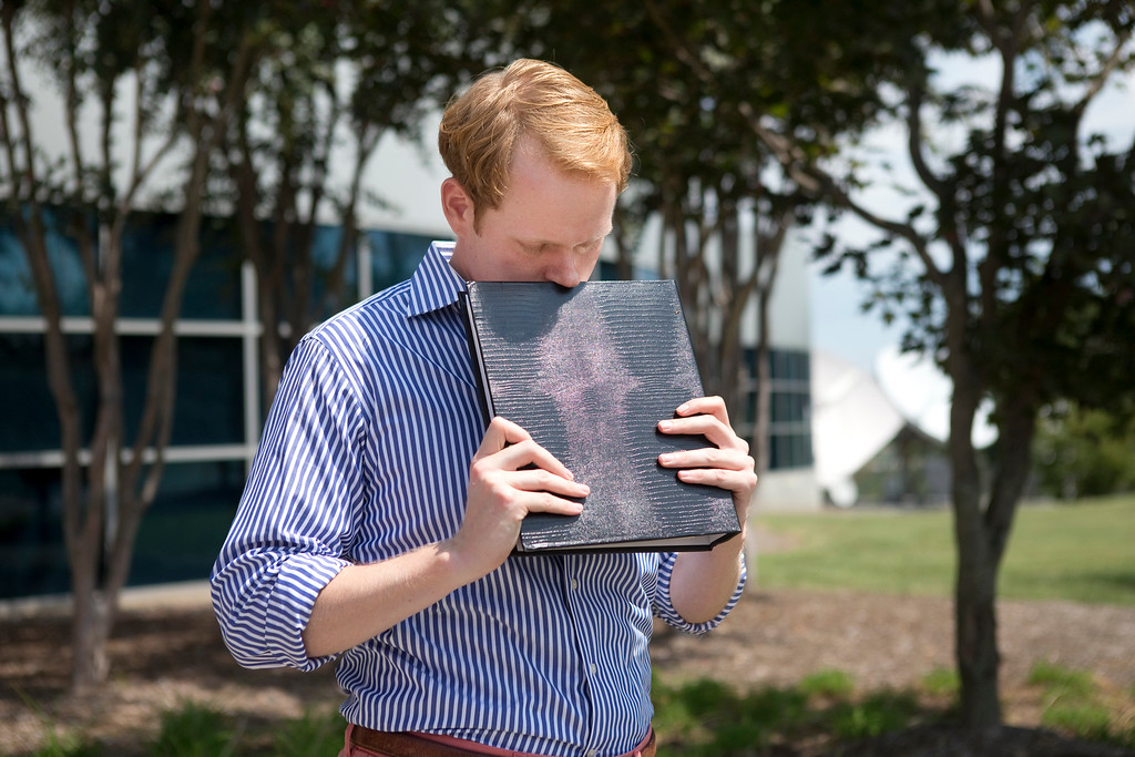 . WDBJ news anchor Chris Hurst pauses as he is overcome with emotion while holding a photo album that was created by fellow reporter and girlfriend Alison Parker, in Roanoke, Va., Wednesday, Aug. 26, 2015. Vester Lee Flanagan opened fire during a live on-air interview for WDBJ, killing Parker and cameraman Adam Ward. (Erica Yoon/The Roanoke Times via AP) LOCAL STATIONS OUT; LOCAL INTERNET OUT; LOCAL PRINT OUT (SALEM TIMES REGISTER; FINCASTLE HERALD; CHRISTIANSBURG NEWS MESSENGER; RADFORD NEWS JOURNAL; ROANOKE STAR SENTINEL; MANDATORY CREDIT MAGS OUT/ NO SALES