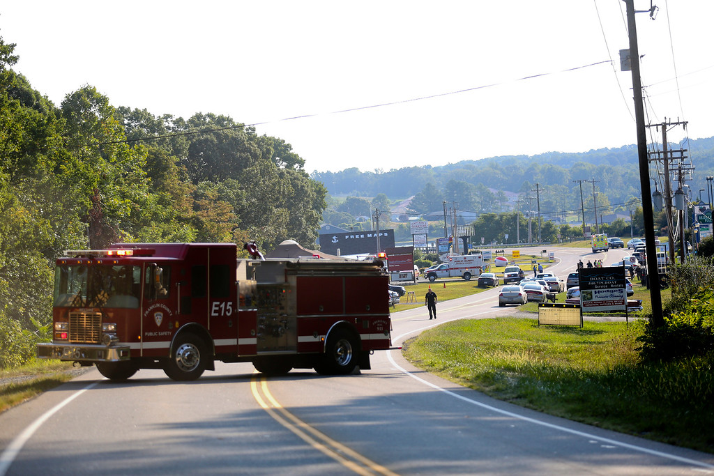 . Authorities block Virginia State Route 122 at Bridgewater Plaza, Wednesday, Aug. 26, 2015, in Moneta, Va., after two journalists were fatally shot while broadcasting live from the plaza earlier in the day. (Stephanie Klein-Davis/The Roanoke Times via AP)