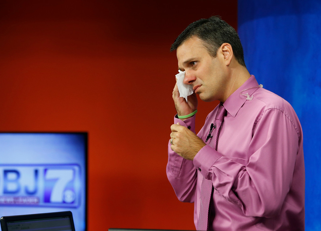 . WDBJ-TV7 meteorologist Leo Hirsbrunner wipes his eyes prior to the early morning newscast at the station, in Roanoke, Va., Thursday, Aug. 27, 2015. Hirsbrunner\'s colleagues Alison Parker and Adam Ward were killed during a live broadcast Wednesday, in Moneta. (AP Photo/Steve Helber)