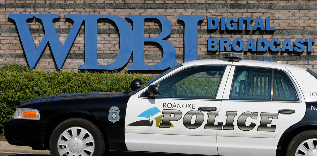 . A Roanoke police cruiser keeps vigil in front of the studios of WDBJ-TV7  in Roanoke, Va., Thursday, Aug. 27, 2015, a day after reporter Alison Parker and cameraman Adam Ward from the station were killed during a live broadcast Wednesday.    (AP Photo/Steve Helber)