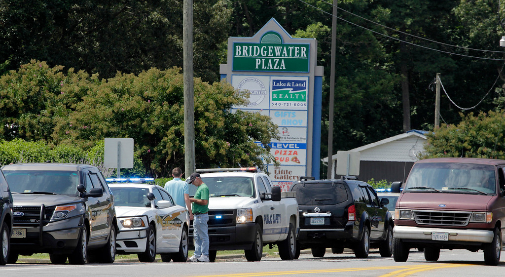 . Police cars are parked at Bridgewater Plaza on Smith Mountain Lake on August 26, 2015 in Moneta, Virginia. Two employees of WDBJ TV were killed this morning during a live broadcast. The victims have been identified as reporter Alison Parker and camerman Adam Ward. Parker, 24 and Ward, 27, worked for WDBJ in Roanoke, Virginia. The suspect, Vester Lee Flanigan, also known as Bryce Williams, died of a self-inflicted gunshot wound. (Photo by Jay Paul/Getty Images)