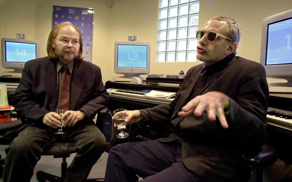 . Walter Becker, left, and Donald Fagen, right, of Steely Dan fame, speak with members of the media during an interview at Berklee College of Music, in Boston, Friday, May 11, 2001.   (AP Photo/Steven Senne)