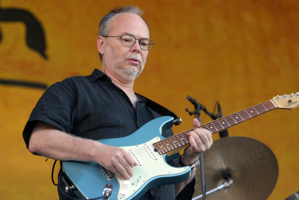 . File - Walter Becker, of Steely Dan, performs during the 2007 Jazz and Heritage Festival in New Orleans on Sunday, May 6, 2007.  Becker, the guitarist, bassist and co-founder of the rock group Steely Dan, has died. He was 67. His official website announced his death Sunday, Sept. 3, 2017. (AP Photo/Dave Martin)