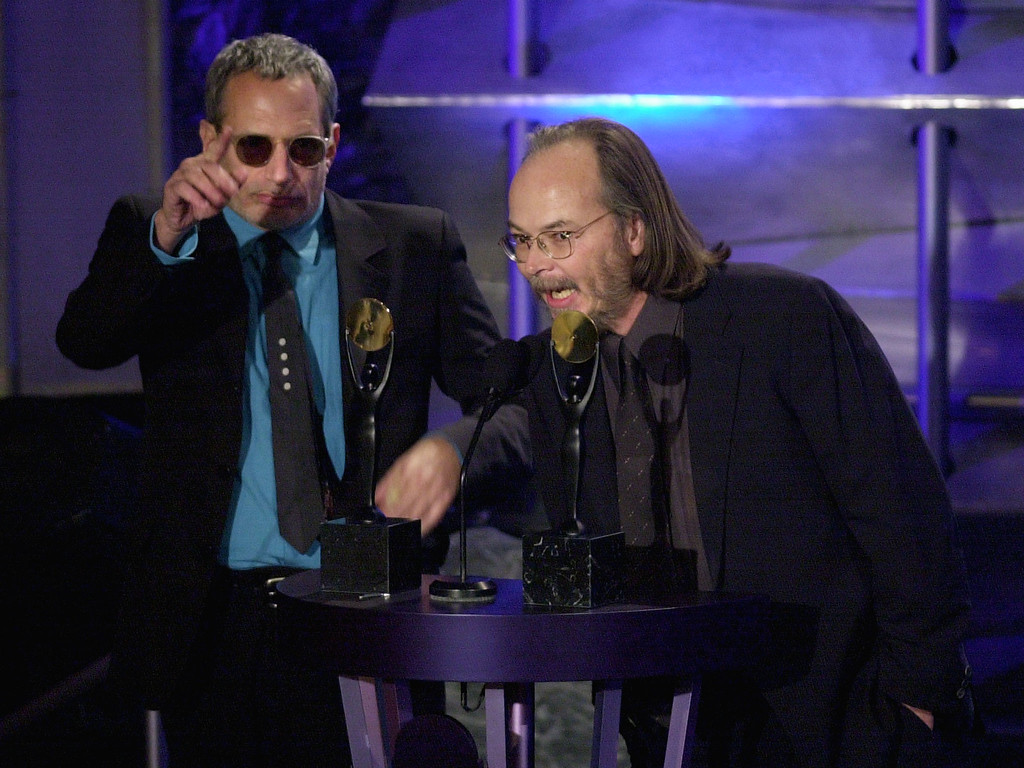 . File - Donald Fagen (L) and Walter Becker (R) of the Rock band Steely Dan accept their induction into the Rock and Roll Hall of Fame 19 March, 2001, at the Waldorf Astoria Hotel in New York. The duo also performed at the 16th annual dinner.  Becker, the guitarist, bassist and co-founder of the rock group Steely Dan, has died. He was 67. His official website announced his death Sunday, Sept. 3, 2017. (STAN HONDA/AFP/Getty Images)