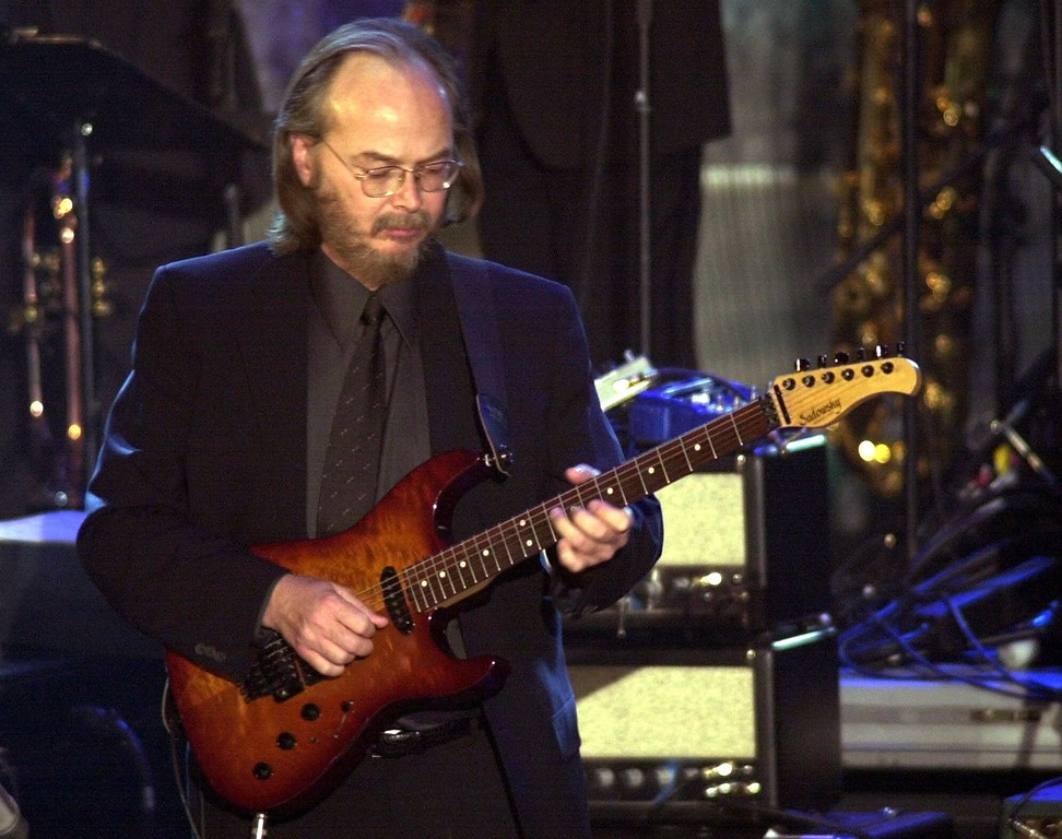 . File - Steely Dan\'s Walter Becker performs onstage at the 16th Annual Rock and Roll Hall of Fame Induction Dinner Monday, March 19, 2001, in New York. Becker, the guitarist, bassist and co-founder of the rock group Steely Dan, has died. He was 67. His official website announced his death Sunday, Sept. 3, 2017, with no further details. (AP Photo/Nick Ut, File) (AP Photo/Kathy Willens)