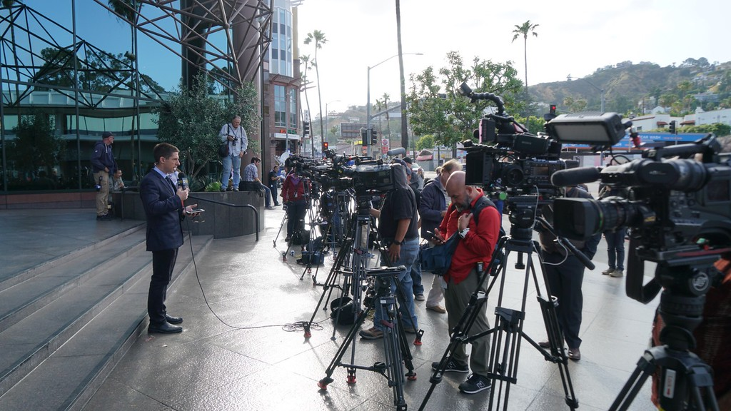 . News media representatives wait outside the Directors Guild of America building, where FBI director James Comey was scheduled to speak to an early-evening FBI diversity recruitment gathering in Hollywood, Calif. on Tuesday, May 9, 2017. FBI spokeswoman Laura Eimiller said he would not be at the event, as President Donald Trump abruptly fired Comey earlier in the day. (Photo by Matthew Carey/Special to the Los Angeles Daily News)