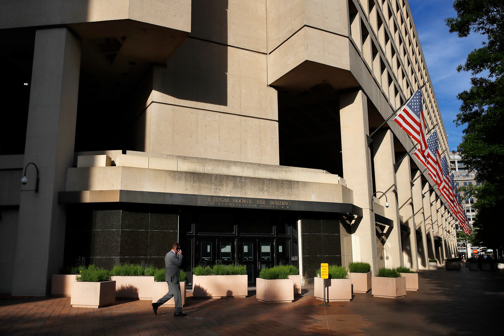 . The J. Edgar Hoover FBI building on Pennsylvania Avenue in Washington, Tuesday, May 9, 2017. President Donald Trump abruptly fired FBI Director James Comey Tuesday, ousting the nation\'s top law enforcement official in the midst of an investigation into whether Trump\'s campaign had ties to Russia\'s election meddling. (AP Photo/Jacquelyn Martin)