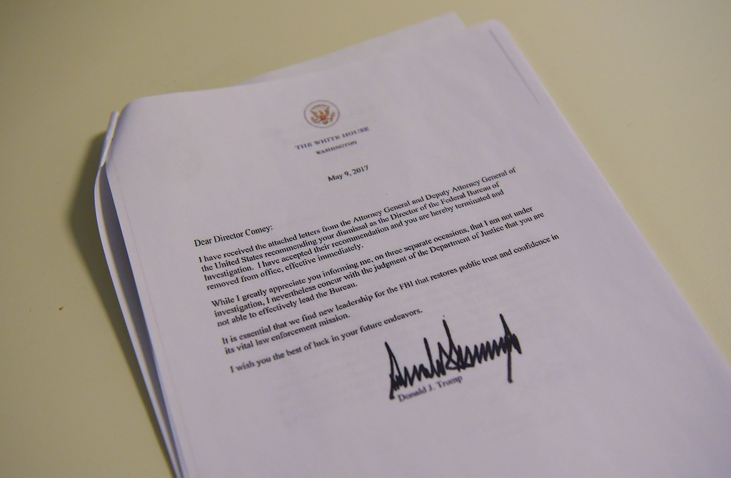 . A copy of the termination letter to FBI Director James Comey from US President Donald Trump is seen at the White House on May 9, 2017 in Washington, DC. US President Donald Trump on Tuesday made the shock decision to fire his FBI director James Comey, the man who leads the agency charged with investigating his campaign\'s ties with Russia.The surprise dismissal of Comey, who played a controversial role in the 2016 presidential election, is sure to send shockwaves through Washington. (MANDEL NGAN/AFP/Getty Images)