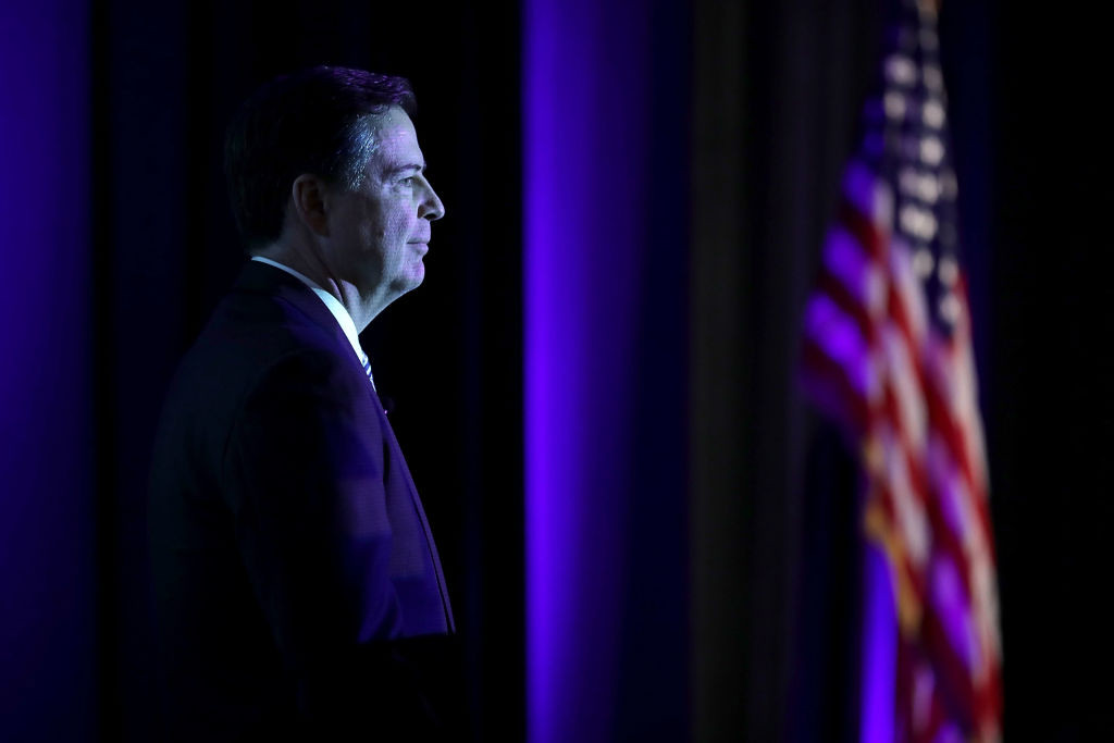 ". File - Federal Bureau of Investigation Director James Comey delivers the keynote remarks at the Intelligence and National Security Alliance Leadership Dinner March 29, 2017 in Alexandria, Virginia. President Donald Trump has fired Comey. In a statement released Tuesday, May 9, Trump says Comey�s firing �will mark a new beginning� for the FBI.""  (Photo by Chip Somodevilla/Getty Images)"