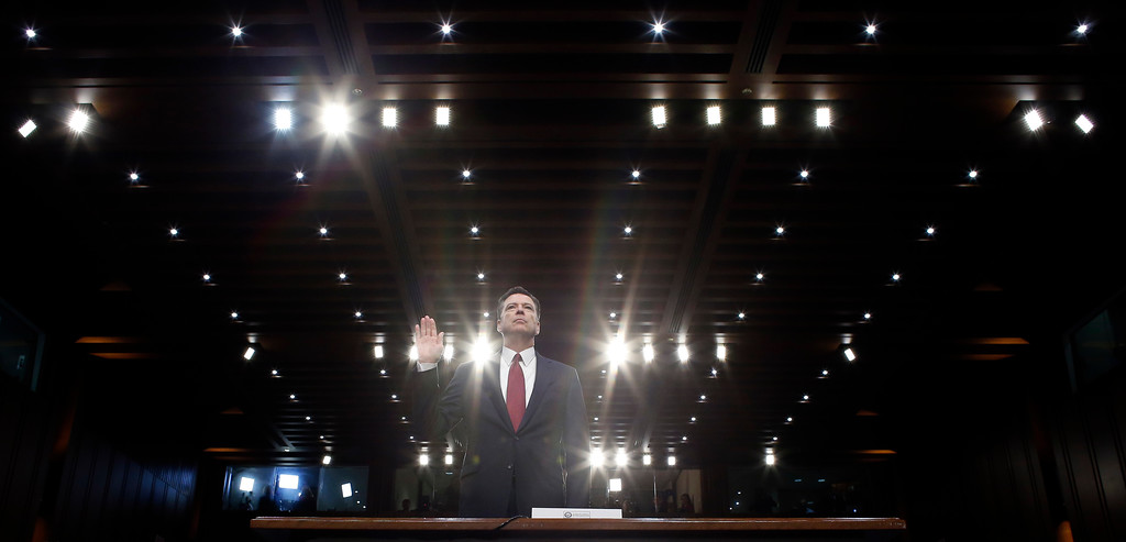 . Former FBI director James Comey is sworn in during a Senate Intelligence Committee hearing on Capitol Hill, Thursday, June 8, 2017, in Washington. (AP Photo/Alex Brandon)