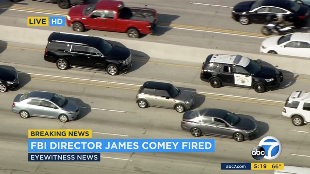 . This still frame from video provided by KABC-TV shows the motorcade carrying former FBI director James Comey in traffic on Interstate 405, enroute to Los Angeles International Airport, Tuesday, May 9, 2017. Comey was scheduled to make an early-evening speech in Los Angeles, but was fired by President Donald Trump earlier in the day. (KABC-TV via AP)