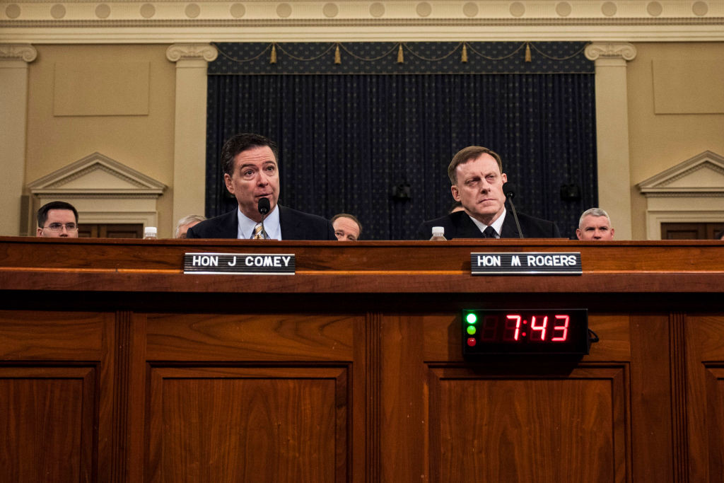. File - (L-R) James Comey, Director of the Federal Bureau of Investigation (FBI), and Michael Rogers, Director of the National Security Agency, testify during a House Permanent Select Committee on Intelligence hearing concerning Russian meddling in the 2016 United States election, on Capitol Hill, March 20, 2017 in Washington, DC. President Donald Trump has fired Comey. In a statement released Tuesday, May 9, Trump says Comey�s firing �will mark a new beginning� for the FBI. (Photo by Zach Gibson/Getty Images)