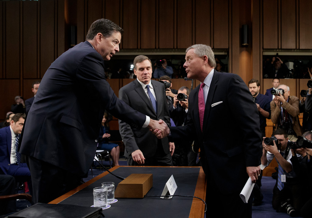 . Former FBI director James Comey, left, is welcomed by Senate Intelligence Committee Chairman Richard Burr, R-N.C., right, with Vice Chairman Mark Warner, D-Va., center, as he arrives to testify before the Senate Select Committee on Intelligence on Capitol Hill in Washington, Thursday, June 8, 2017.  (AP Photo/J. Scott Applewhite)