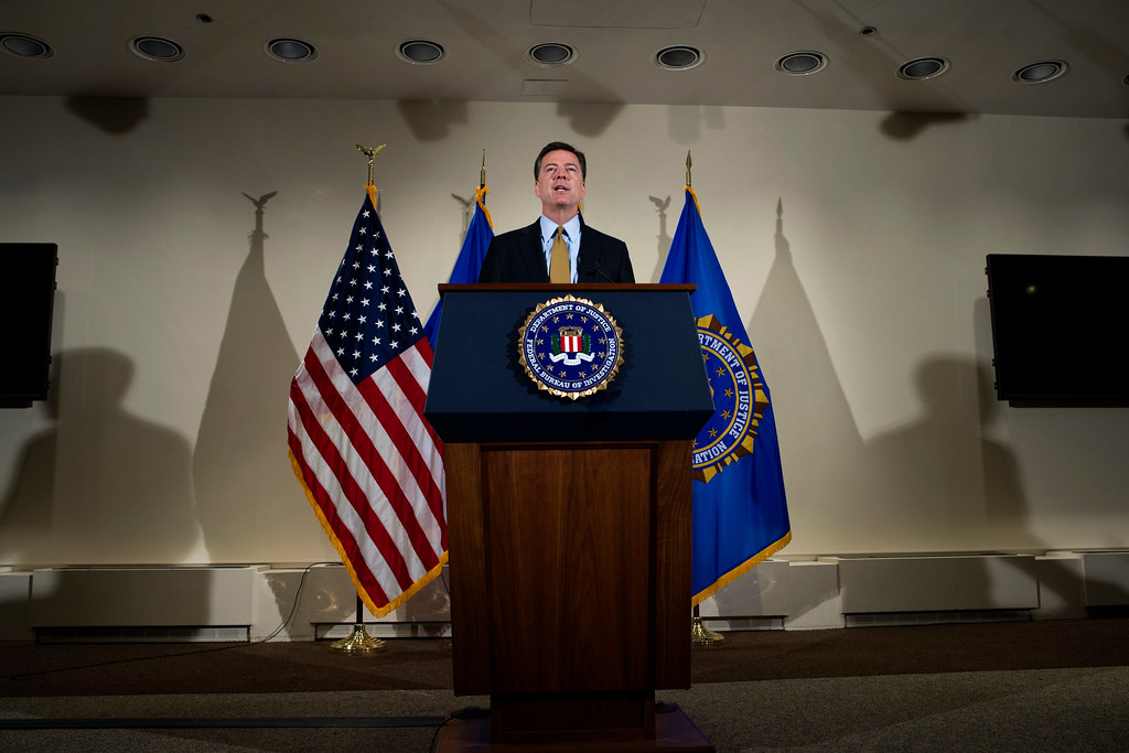 . In this 2016 file photo, FBI Director James Comey makes a statement at FBI Headquarters in Washington, Tuesday, July 5, 2016. Comey said the FBI will not recommend criminal charges in its investigation into Hillary Clinton\'s use of a private email server while secretary of state. President Donald Trump has fired Comey. In a statement released Tuesday, May 9, Trump says Comey�s firing �will mark a new beginning� for the FBI. (AP Photo/Cliff Owen)